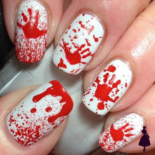 Diseños de uñas para halloween manos sangre