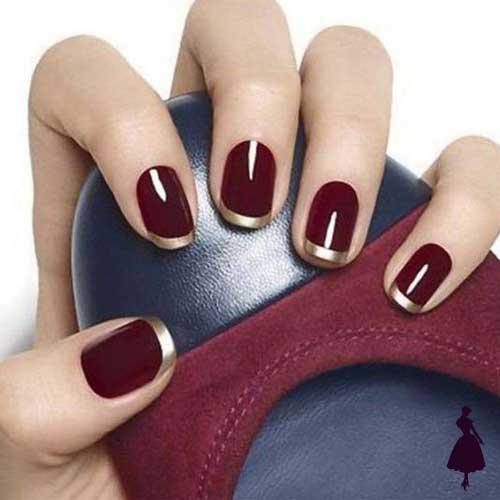 Diseños de uñas color burdeo con dorado